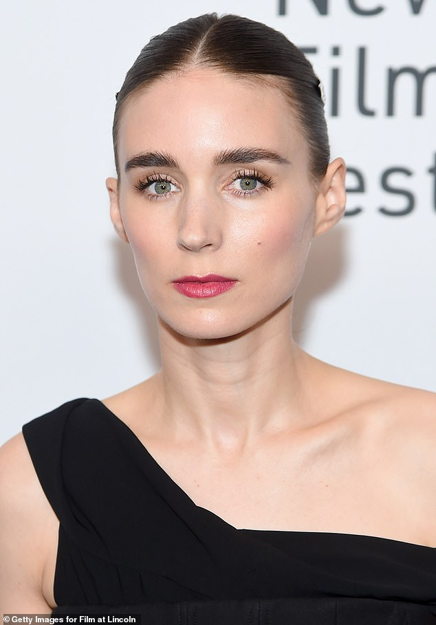 Perfect face:The only pop of color in Rooney's ensemble were her stark pink lips, and a touch of blush