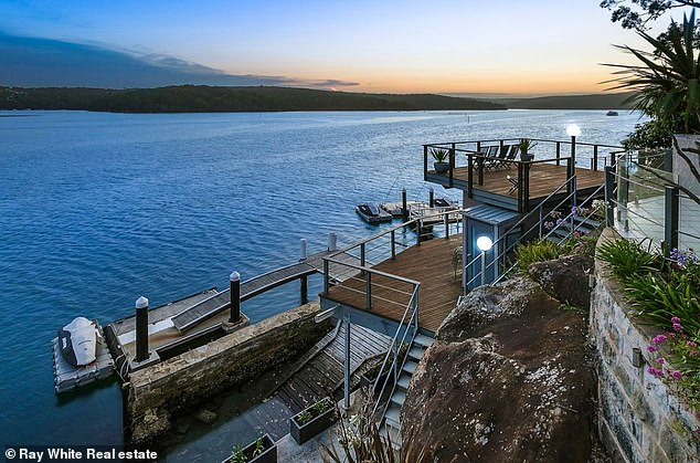 The extravagant waterfront property comes with a boat ramp and overlooks the Royal National Park