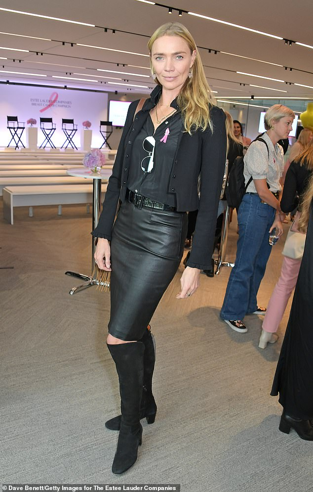 Edgy:Jodie opted for a more muted ensemble by teaming a relaxed black shirt and a tight leather midi skirt and knee-high suede boots