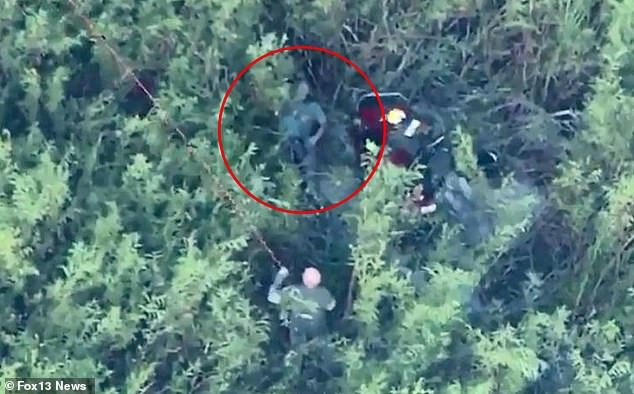 Dramatic aerial footage shows two pilots lying in a central Florida swamp after having survived two separate crash landings in a helicopter and agyrocopter