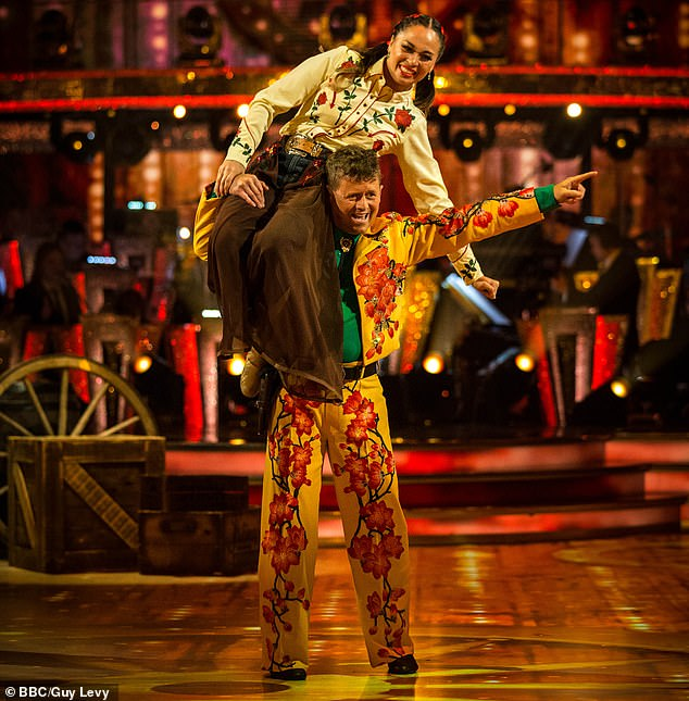Mike Bushell, 53,stunned Strictly Come Dancing viewers with an over-the-top cowboy-themed American Smooth that left some fearing for the safety of his dance partner Katya Jones