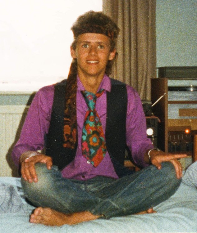 Bushell can be seen as a sixth-former in 1985, sitting cross- legged on his bed dressed like a hippie with a tie around his head taming his curly locks