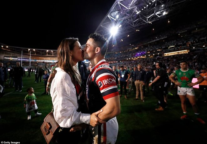 Cooper Cronk kisses his wife Tara Rushton after the Roosters' 14 to eight victory against the Canberra Raiders on Sunday night