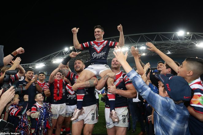 Cooper Cronk is chaired off the field by Jared Waerea-Hargreaves (left) and Boyd Cordner (right) after playing his 372nd and last ever game