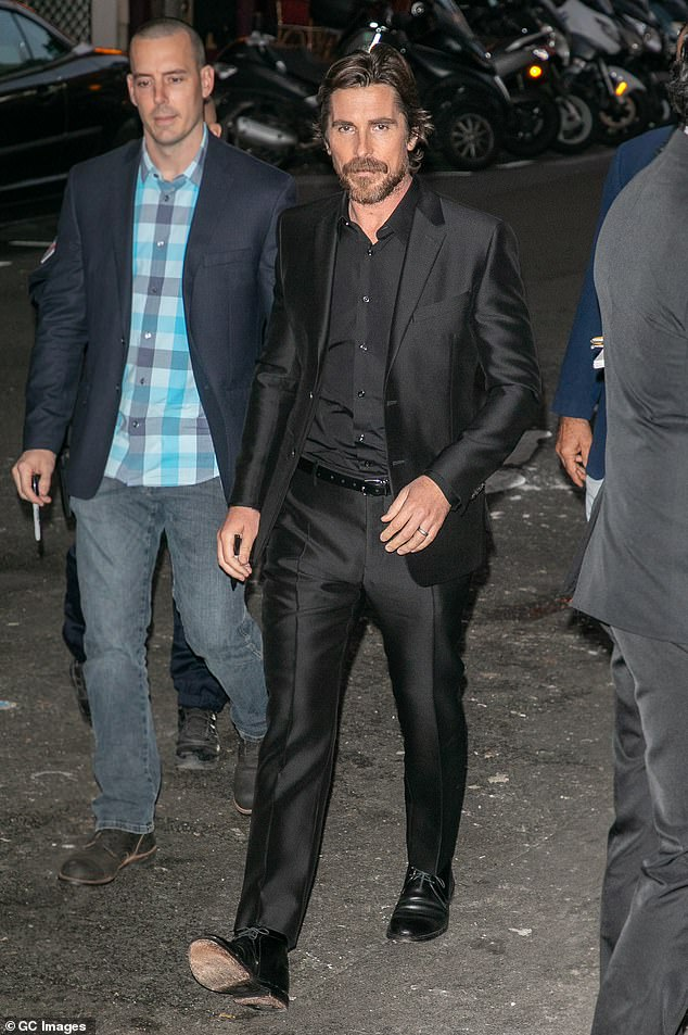 Suave: Christian embraced his Dark Knight past for his sophisticated ensemble in Paris