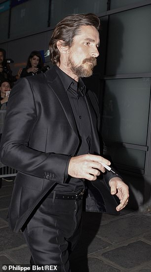 Man in black: Even the actors accessories matched his suit