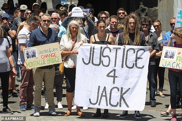 Aston's wife Wendy Aston, daughter Meg Aston and son Ben Aston, rally against his sentence of five years and three months