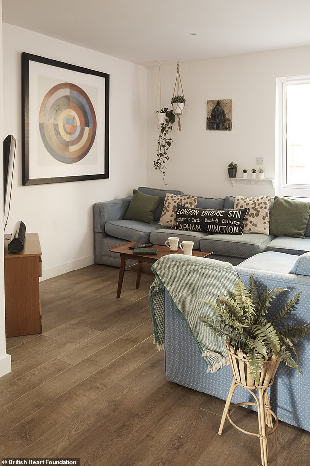 The doctors decorated the living room with plants , hanging baskets and throw pillows. They bought the picture £50, the coffee table £20 and a new TV Cabinet for £75, revamping the main room for just £145