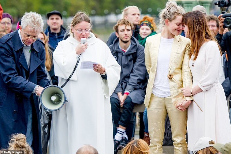 An Extinction Rebellion couple getting married at an action site that is being called 'The Beacon' on Westminster Bridge