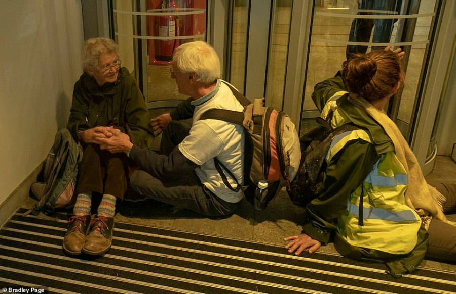 Inside the Home Office people glued themselves to the doors including a pair of pensioners who were holding hands