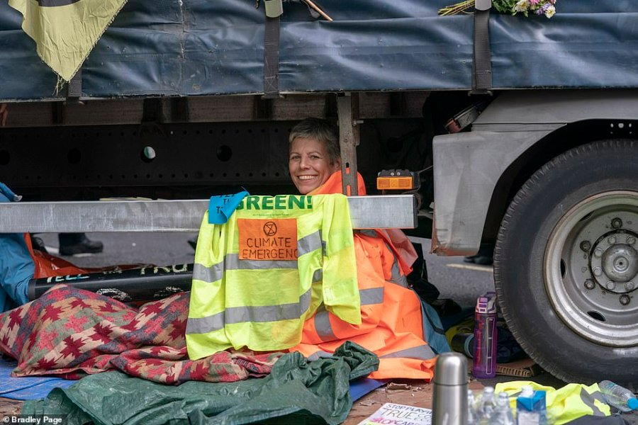 Extinction Rebellion climate protesters looked happy to be be attached to a lorry outside the Home Office