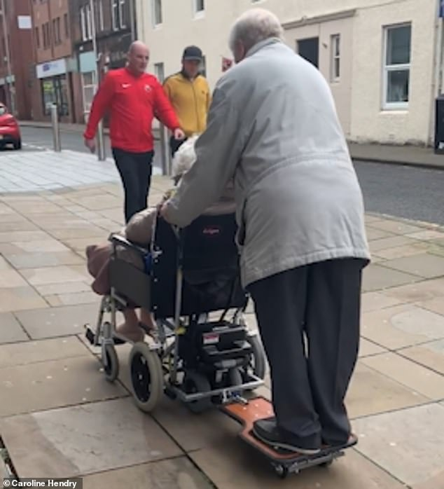 The elderly couple (pictured) were recorded driving down the path in Ayr, Scotland, on Sunday