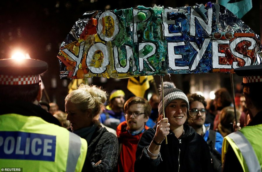 Extinction Rebellion activists continue protesting outside Whitehall on Tuesday evening. 531 people have been arrested so far in the first two days of the protests