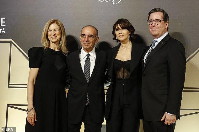 L-R:President of the Film Academy David Rubin (R), Monica, CEO of Film Academy Dawn Hudson (L) and Italian director Giuseppe Tornatore