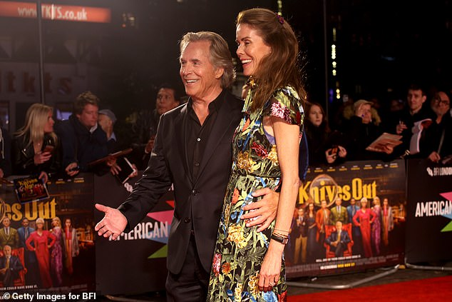 Smitten: Don rested his hand on Kelley's waist and looked happy to be back on a red carpet