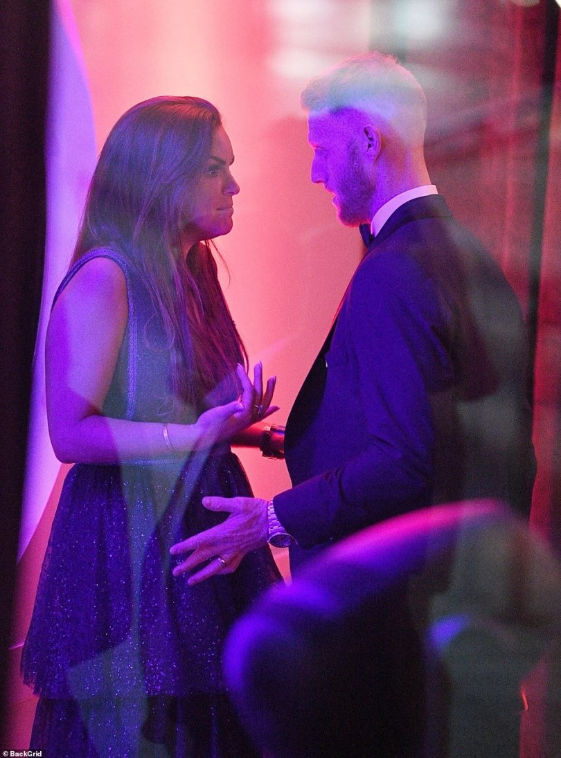 The couple have a private chat at the awards ceremony away from the other guests prior to Mr Stokes grabbing his wife's face