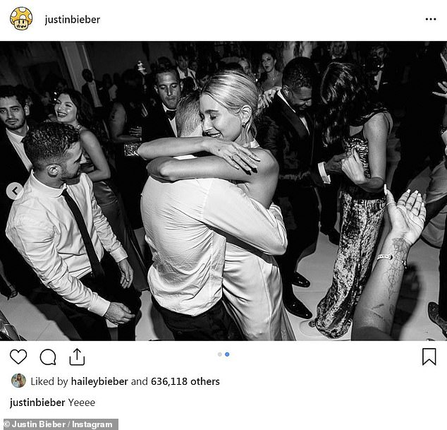 Man and wife: The newlyweds shared a tender embrace as guests danced around them