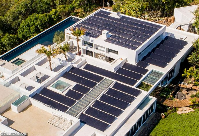 Setting a good example: The roof is now almost completely covered with rectangular solar panels, just in time for the sweltering Australian summer