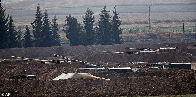 Turkish artillery batteries near the border with Syria are seen as the country prepares for an assault against Kurdish forces