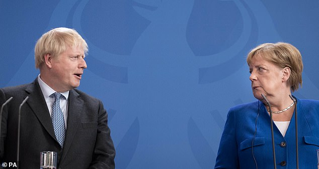Boris Johnson is pictured in a tense exchange with German Chancellor Angela Merkel in Berlin in August