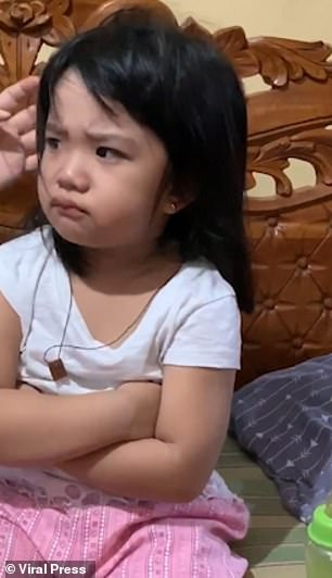 Four-year old Carlyn did not cheer up when her auntie and grandma made a fuss of her
