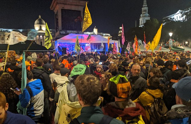 Activists were free to rave at a giant Orbital gig and party in Trafalgar Square last night (pictured) - ignoring a warning from police that they faced arrest