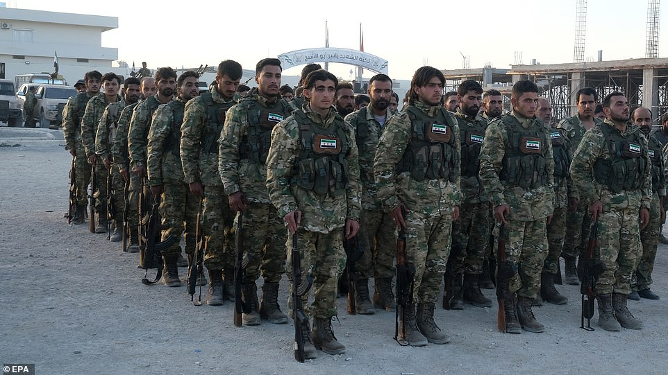 Turkey-backed members of Syrian National Army prepare for moving to Turkey for an expected military operation by Turkey into Kurdish areas of northern Syria