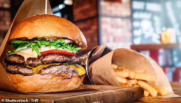Eating food high in fat can cause dietary fats to seep into the brain and affect thefunctioning of part of the brain that controls our emotions, leading to an increase in depressive symptoms (file image)