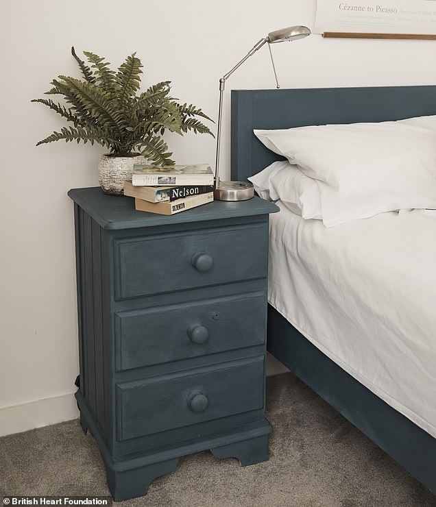 In one bedroom, the group painted an oak bed frame and a peeling white chest of drawers dark blue, giving the room a classier and more sophisticated feel (pictured after)