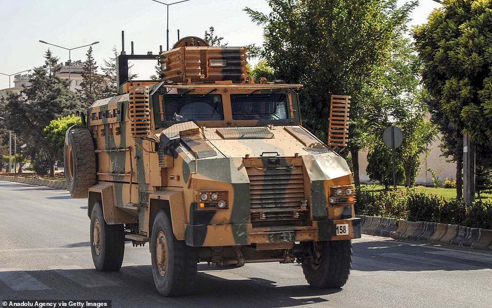 Turkish Armed Forces' armoured vehicles and armored personnel carriers, carrying Turkish commandos move towards to Turkey's Syrian border as they are being dispatched to support the units at the border, in Kilis today