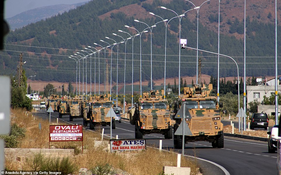 Turkish commandos inarmoured vehicles were seen travellingtowards the Syrian border today as they are being dispatched to support border units in Hatay, Turkey