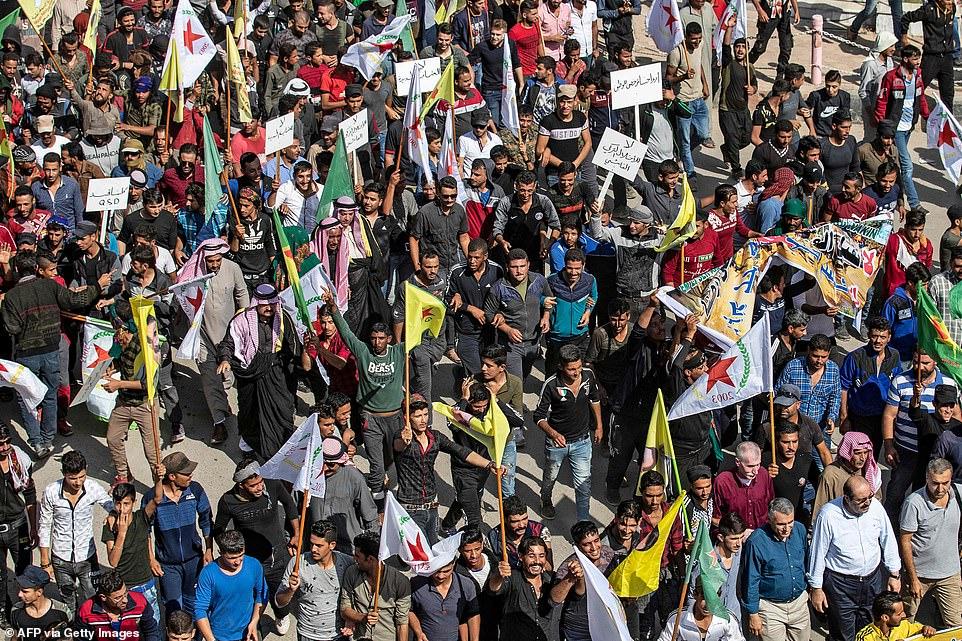 Syrian Kurds demonstrating against Turkish threats in Ras al-Ain town in Syria today. Turkey's planned invasion began today as airstrikes were launched on Kurdish positions