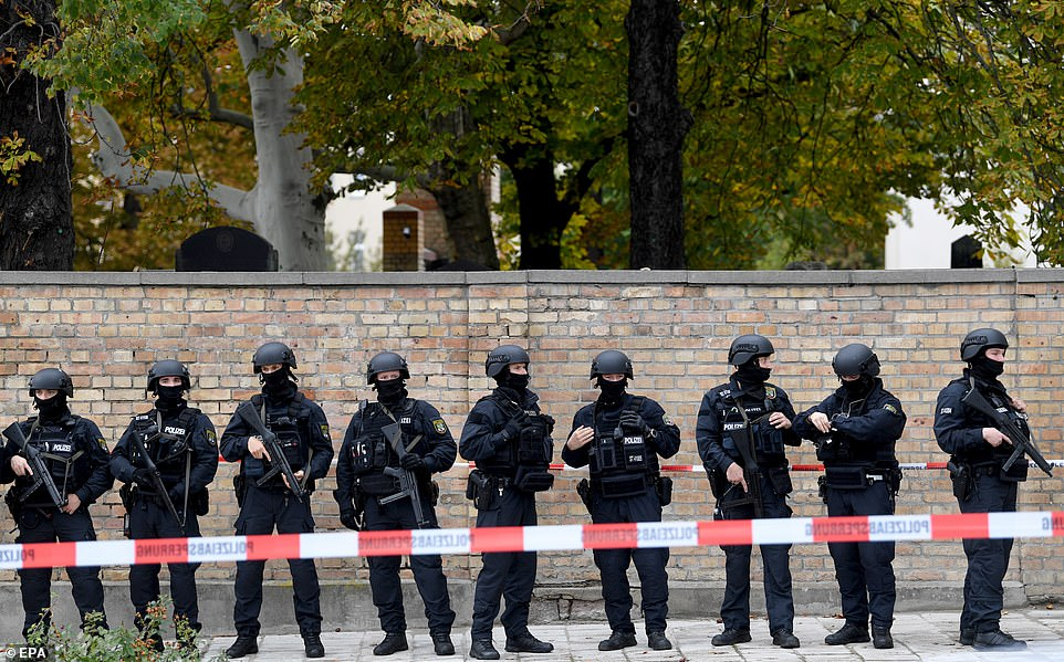 Police guard a crime scene near a Synagogue after a shooting in Halle, Germany, which targeted Yom Kippur worshippers