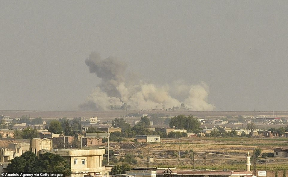 Smoke rises at the site Ras al-Ayn city as Turkish troops along with the Syrian National Army begin Operation Peace Spring in northern Syria against PKK/YPG and ISIS