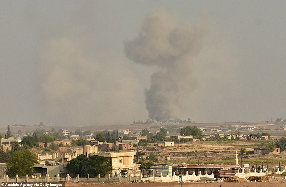 Kurdish-led Syrian Democratic Forces (SDF) said Turkish warplanes struck its region in the northeast, sparking 'huge panic among people' today. Pictured smoke rising after a Turkish airstrike