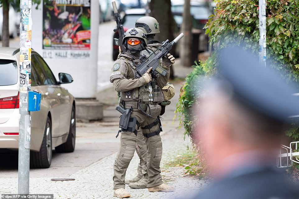 Special police forces officers armed with sub-machine guns patrol after the attack in Halle an der Saale on Wednesday