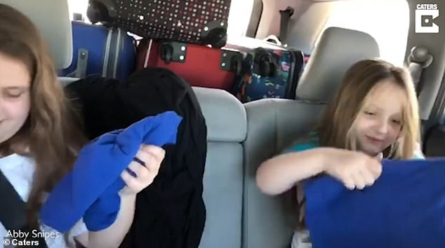 Cecilia and Harper were filmed by their parents on their journey to Port Canaveral, Florida, where the girls thought they were going to the beach. They werehanded their daughters Disney-emblazoned t-shirts which left them baffled