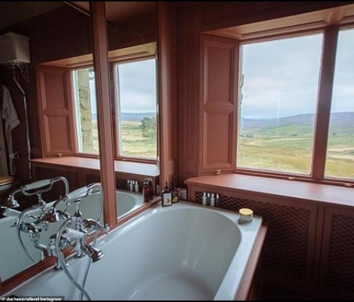 Meanwhile, the Grade II listed building offers a simpler bathroom with breathtaking views of the surrounding countryside
