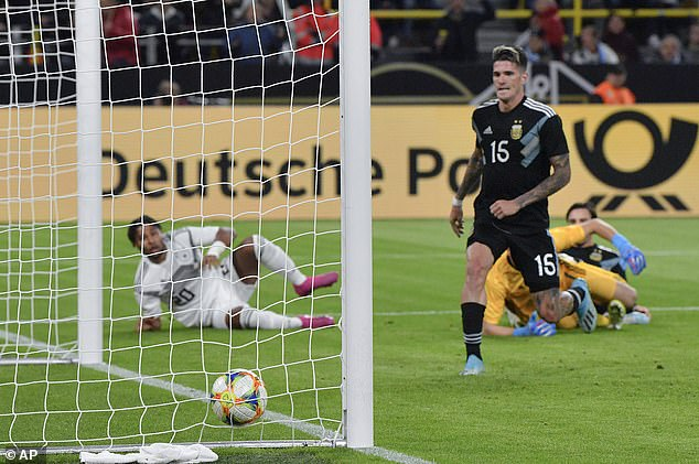 Rodrigo De Paul gave chase but could only watch as Gnabry's effort bounced over the line