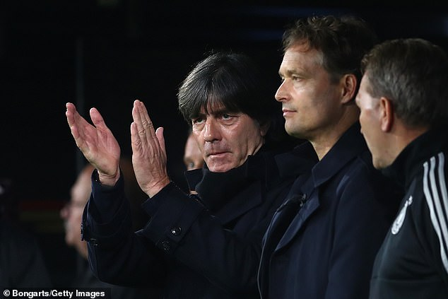 Germany boss Joachim Low applauds his players after a dominant first half performance