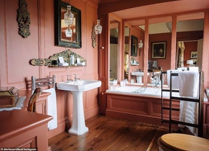 "This bathroom is referred to as Emma's ""Favorite Bath"" and features paintings, mirrored walls and views of the surrounding countryside"