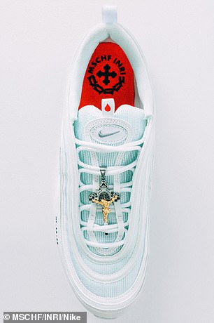 Tribute: A red insole is meant to represent the red shoes that were traditionally worn by the Pope when he went outside
