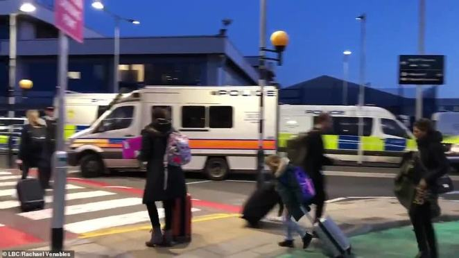 Teams of police officers descended on London City Airport this morning as flight passengers braced for chaos