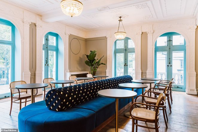 The modern and creative design at Public Hall in London includes blue velvet sofas, funky wallpaper and high ceilings