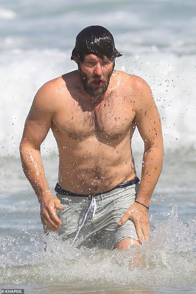 Under the sea: The talented actorwas seen emerging from under the water, his wet hair falling across his face