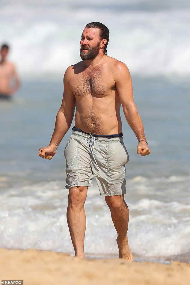 Keeping busy: His swim came just hours before Joel stepped out for the film's Sydney premiere later that same night