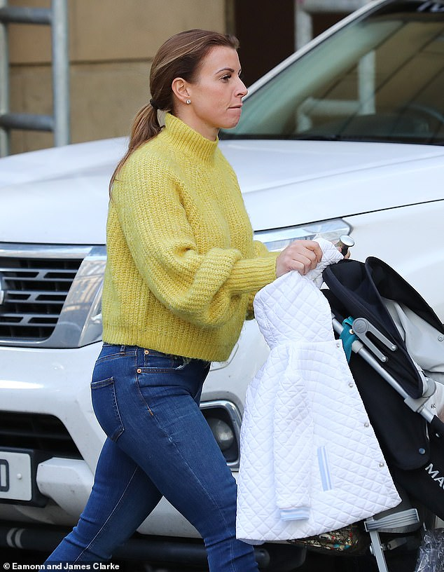 Out and about: Coleen Rooney emerged in Manchester on Thursday as her spat with Rebekah Vardy rages on following her allegations of story leaking the previous day