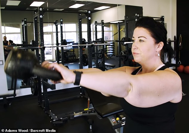 Holding her back: Noelle, pictured earlier this year, said her excess skin was beginning to get in the way at the gym