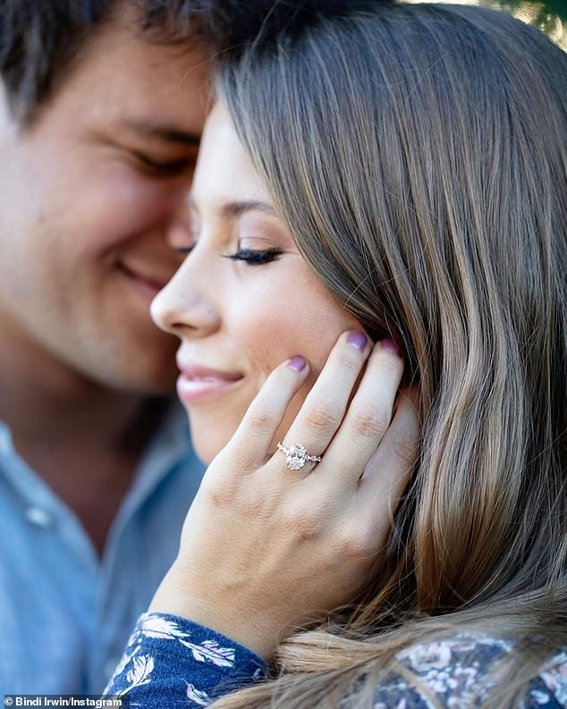 Together forever: In July, Bindi announced her engagement toChandler Powell via Instagram sharing a photo of her diamond ring
