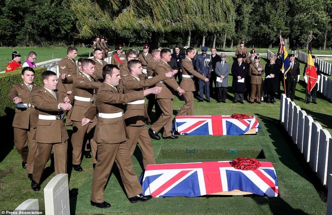 Soldiers preparing to bury two coffins.The burial with full military honours is the culmination of the 'Dig Hill 80' project that discovered the remains of the soldiers in 2018